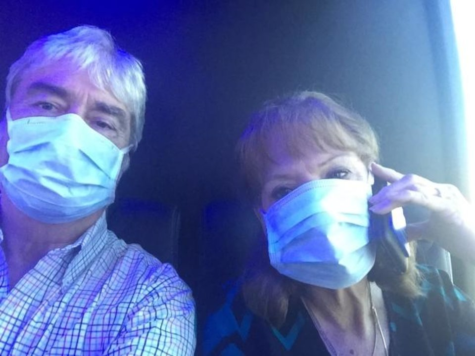 Photo -  David Von Tungeln and his wife Maribeth take a selfie in Georgia before boarding a plane back to Oklahoma, ending ten days confined to a cruise ship and military housing because of coronavirus concerns.   [Photo provided]