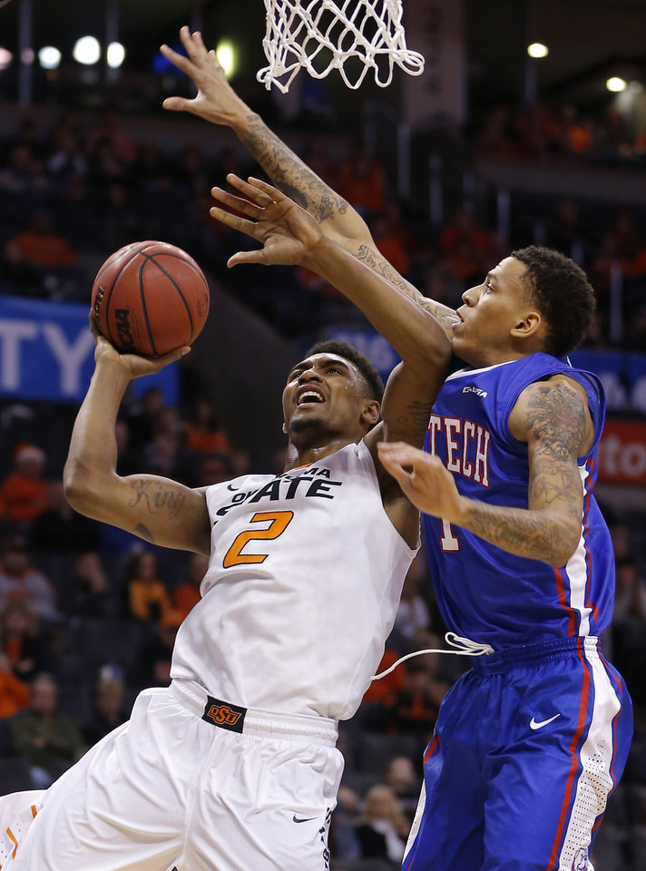 Photo - Oklahoma State's Le'Bryan Nash (2) goes to the basket beside Louisiana Tech's Michale Kyser (1) during the All-College Classic basketball game between Oklahoma State University and Louisiana Tech at Chesapeake Energy Arena in Oklahoma City, Okla., Saturday, Dec. 14, 2013. Photo by Bryan Terry, The Oklahoman