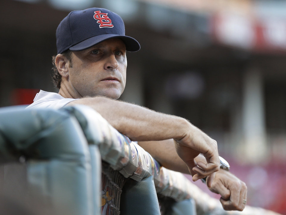 Photo - St. Louis Cardinals manager Mike Matheny watches from the dugout in the first inning of a baseball game against the Cincinnati Reds, Tuesday, Sept. 3, 2013, in Cincinnati. (AP Photo/Al Behrman)