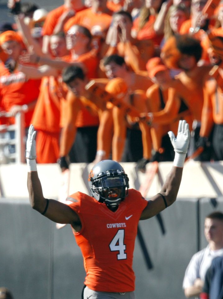 Photo - Oklahoma State's Justin Gilbert (4) celebrates during a college football game between the Oklahoma State University Cowboys (OSU) and the Baylor University Bears (BU) at Boone Pickens Stadium in Stillwater, Okla., Saturday, Oct. 29, 2011. Photo by Sarah Phipps, The Oklahoman