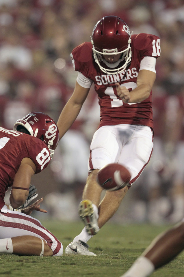 Oklahoma Sooners' Michael Hunnicutt (18) kicks an extra point during the first half of the college football game between the University of Oklahoma Sooners (OU) and the Ball State Cardinals at Gaylord Family-Oklahoma Memorial Stadium on Saturday, Oct. 1, 2011, in Norman, Okla. Photo by Steve Sisney, The Oklahoman