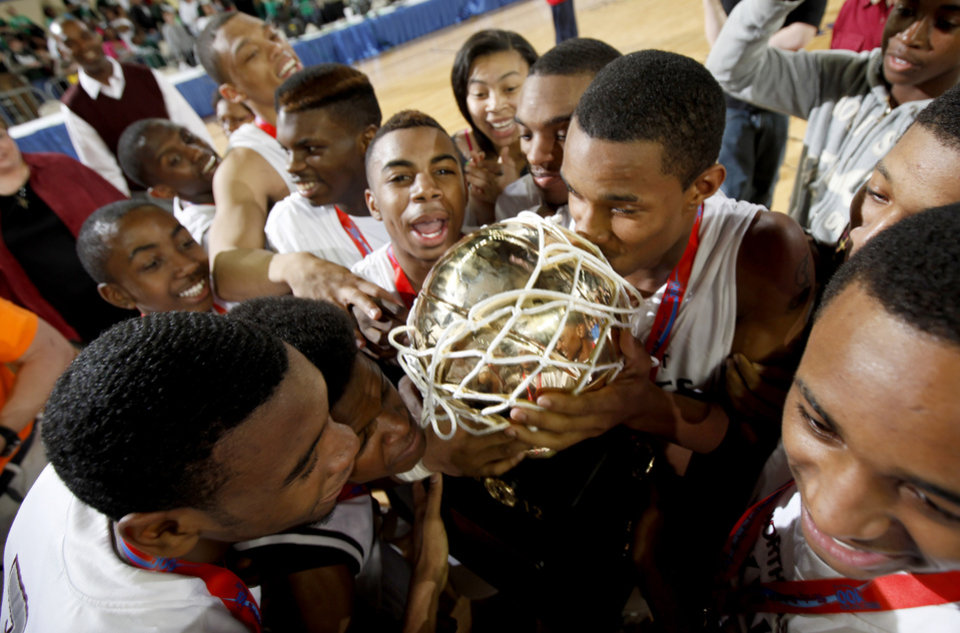 The Northeast team celebrates with the trophy after their win over Haworth in the Class 2A boys high school state basketball championship game at State Fair Arena in Oklahoma City, Saturday, March 10, 2012. Photo by Bryan Terry, The Oklahoman