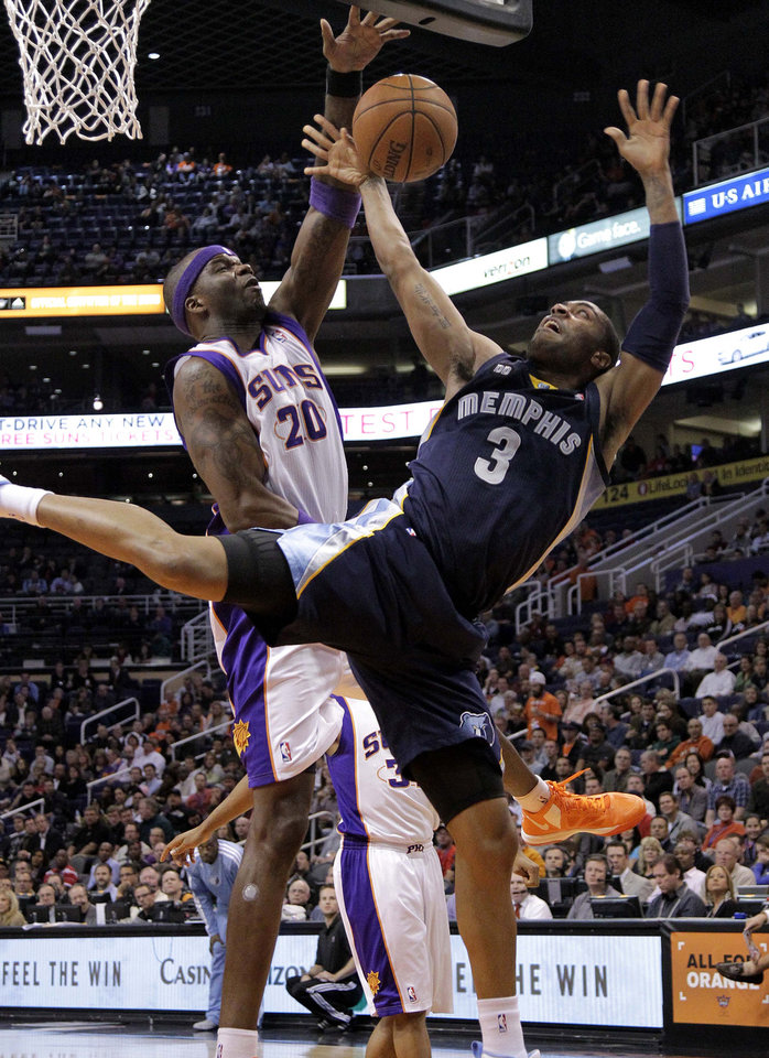 Photo - Memphis Grizzlies' Wayne Ellington (3) has his shot blocked by Phoenix Suns' Jermaine O'Neal during the first half of an NBA basketball game on Wednesday, Dec. 12, 2012, in Phoenix. (AP Photo/Matt York)