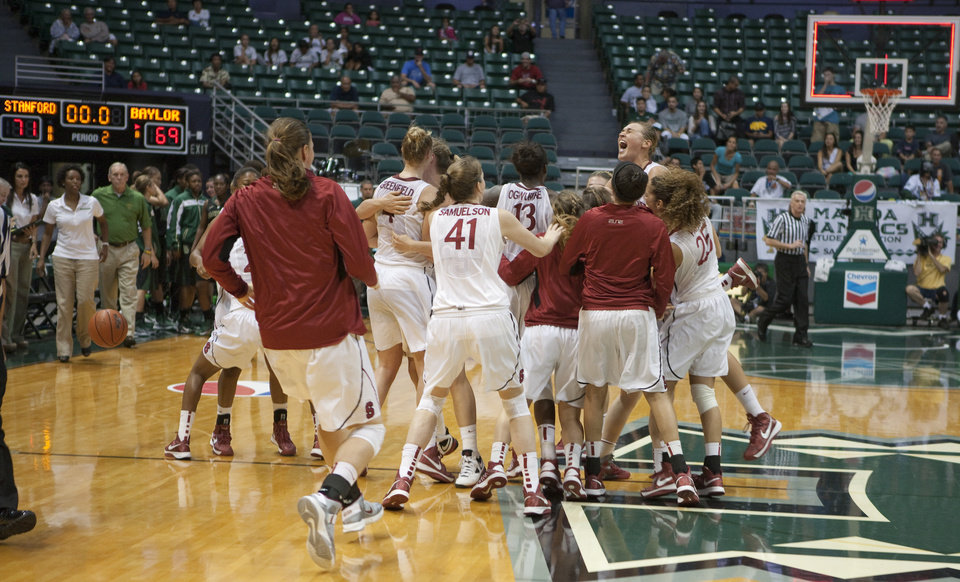 Photo -   Stanford players celebrates after defeating Baylor 71-69 in an NCAA college basketball game Friday, Nov. 16, 2012 in Honolulu. (AP Photo/Marco Garcia)