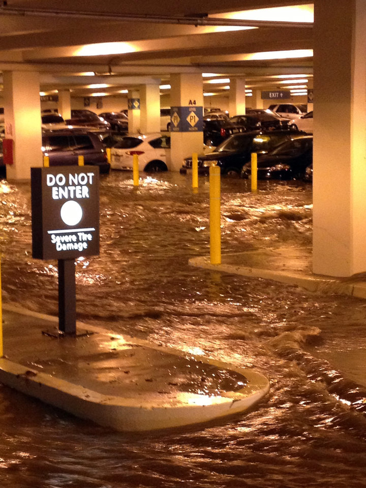 Photo - In this Tuesday, July 29, 2014 photo, water flows into a parking structure at UCLA after a ruptured 93-year-old, 30-inch water main left the Los Angeles campus awash in 8 million gallons of water in the middle of California's worst drought in decades. The water also flooded the school's storied basketball court, which underwent a major renovation less than two years ago. (AP Photo/Anuj Dixit)