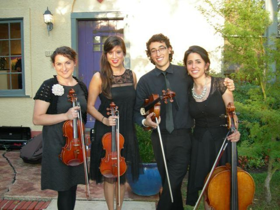 Klaudia Cop , Maria Belen Ruffin, Ulises Serrano  and Diana Ruffin, members of a string quartet, played during the party. (Photo provided).