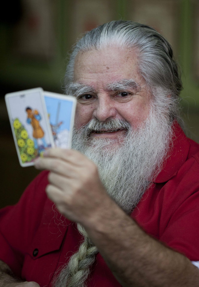 "Antonio Vazquez Alba, popularly known as the ""Grand Warlock,"" holds up Tarot cards as he gives his traditional predictions for the new year during a news conference Friday in Mexico City. AP photo <strong>Eduardo Verdugo</strong>"