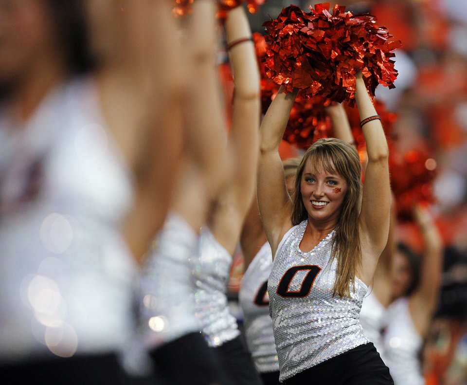 Photo - Memebers of the OSU pom squad dance in the first half of Oklahoma State's game on Saturday. Photo by Nate Billings, The Oklahoman