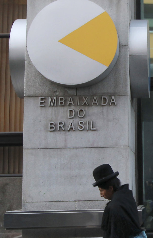 Photo -   A woman walks past the embassy of Brazil in La Paz, Bolivia, Wednesday May 30, 2012. Opposition Bolivia' Senator Roger Pinto took refuge in the Brazilian embassy in La Paz and asked the government of Brazil's President Dilma Rousseff for political asylum. (AP Photo/Juan Karita)