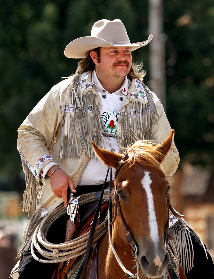 Kevin Webb plays Pawnee Bill at the Pawnee Bill Wild West Show in Pawnee, Oklahoma. Here, he is shown riding in the afternoon parade through downtown Shawnee on Saturday, June 23, 2012. Photo by Jim Beckel, The Oklahoman