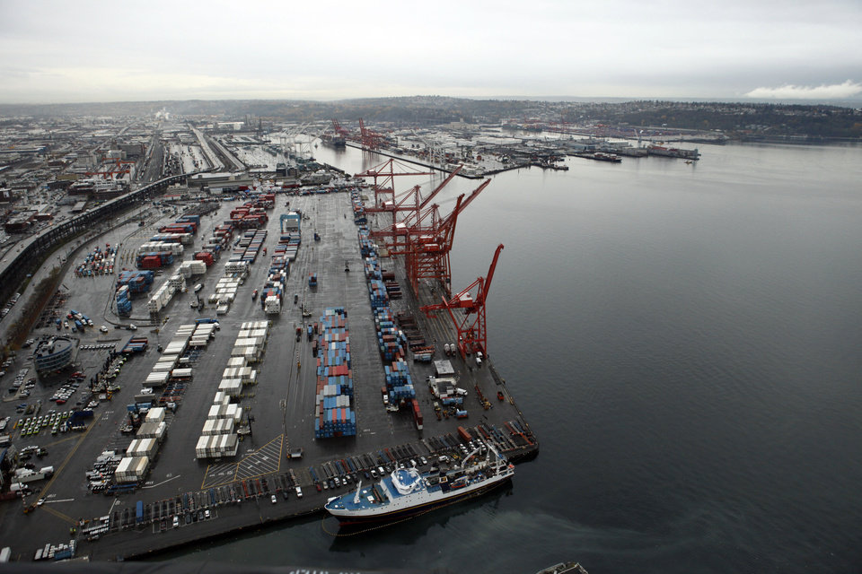 Photo - FILE - This Nov. 19, 2009 file photo shows shipping cranes at the Port of Seattle in downtown Seattle. The West Coast ports that are America's gateway for hundreds of billions of dollars of trade with Asia and beyond are no stranger to labor unrest and even violence. Now, the contract that covers nearly 20,000 dockworkers is set to expire, and businesses that trade in everything from apples to iPhones are worried about disruptions _ as the summer cargo crush begins.  (AP Photo/Elaine Thompson, file)