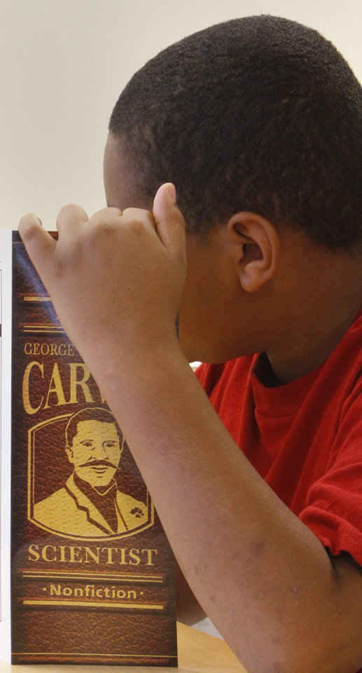 Photo -  A student works in the reading academy for third-graders who are reading below grade level, including those who failed a state reading test and could be held back at Willow Brook Elementary School.    David McDaniel -  The Oklahoman