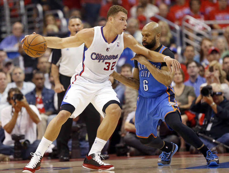 Photo - Oklahoma City's Derek Fisher (6) defends against Los Angeles' Blake Griffin (32) during Game 6 of the Western Conference semifinals in the NBA playoffs between the Oklahoma City Thunder and the Los Angeles Clippers at the Staples Center in Los Angeles, Thursday, May 15, 2014. Photo by Nate Billings, The Oklahoman