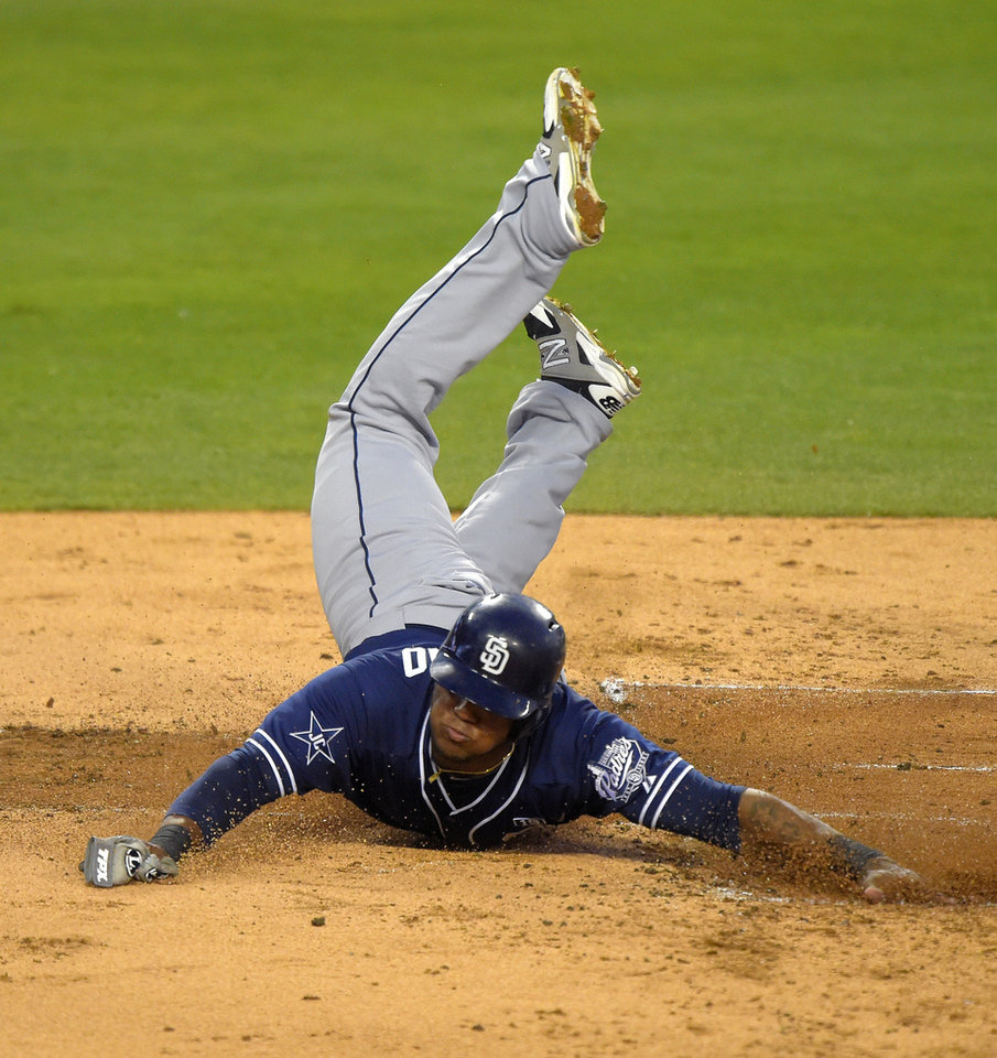Photo - San Diego Padres' Rymer Liriano scores on a fielding error by Los Angeles Dodgers' Scott Van Slyke during the second inning of a baseball game, Wednesday, Aug. 20, 2014, in Los Angeles.  (AP Photo/Mark J. Terrill)