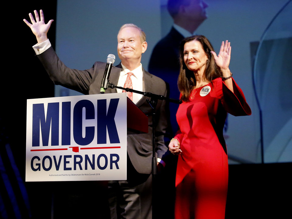 Photo - Mick Cornett and his wife Terri wave to supporters during a concession speech during a watch party at the Tower Theatre in Oklahoma City , Tuesday, Aug. 28, 2018. Photo by Sarah Phipps, The Oklahoman