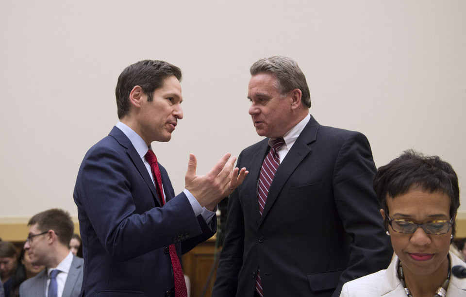 Photo - Centers for Disease Control and Prevention (CDC) Director Dr. Tom Frieden, left, talks with House Foreign Affairs Committee Chairman Rep. Edward R. Royce, R-Calif. as he arrives to on Capitol Hill in Washington, Thursday, Aug. 7, 2014, testify before the House subcommittee on Africa, Global Health, Global Human Rights, and International Organizations hearing on