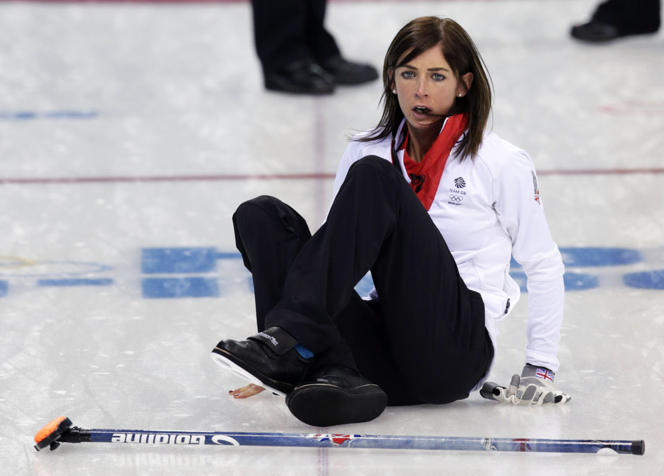 Photo - Great Britain's skip Eve Muirhead slips on the ice while shouting instruction after delivering the rock during women's curling competition against Russia at the 2014 Winter Olympics, Monday, Feb. 17, 2014, in Sochi, Russia. (AP Photo/Robert F. Bukaty)