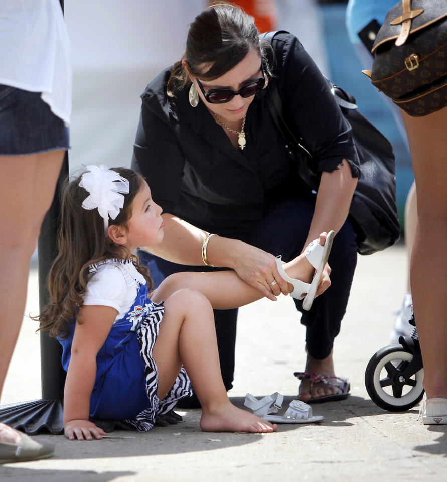 Andrea Williams helps her daughter Joscelyn Williams, 3, with her sandals during the Festival of the Arts in downtown Oklahoma City, Wednesday, April 25, 2012. Photo by Nate Billings, The Oklahoman