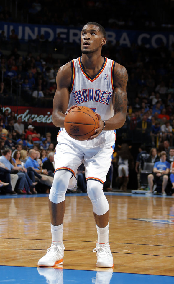 Oklahoma City\'s Perry Jones III (3) shoots a free throw during the preseason NBA game between the Oklahoma City Thunder and the Charlotte Bobcats at Chesapeake Energy Arena in Oklahoma City, Tuesday, Oct. 16, 2012. Photo by Sarah Phipps, The Oklahoman