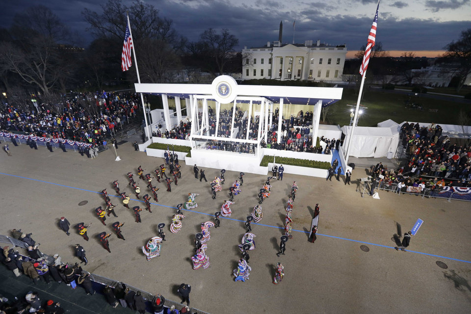 Photo - Palmview High School Mariachi and Folkloric Group, Texas,  perform while passing the presidential box and the White House during the Inaugural parade, Monday, Jan. 21, 2013, in Washington. Thousands  marched during the 57th Presidential Inauguration parade after the ceremonial swearing-in of President Barack Obama. (AP Photo/Charlie Neibergall ) ORG XMIT: DCMS176