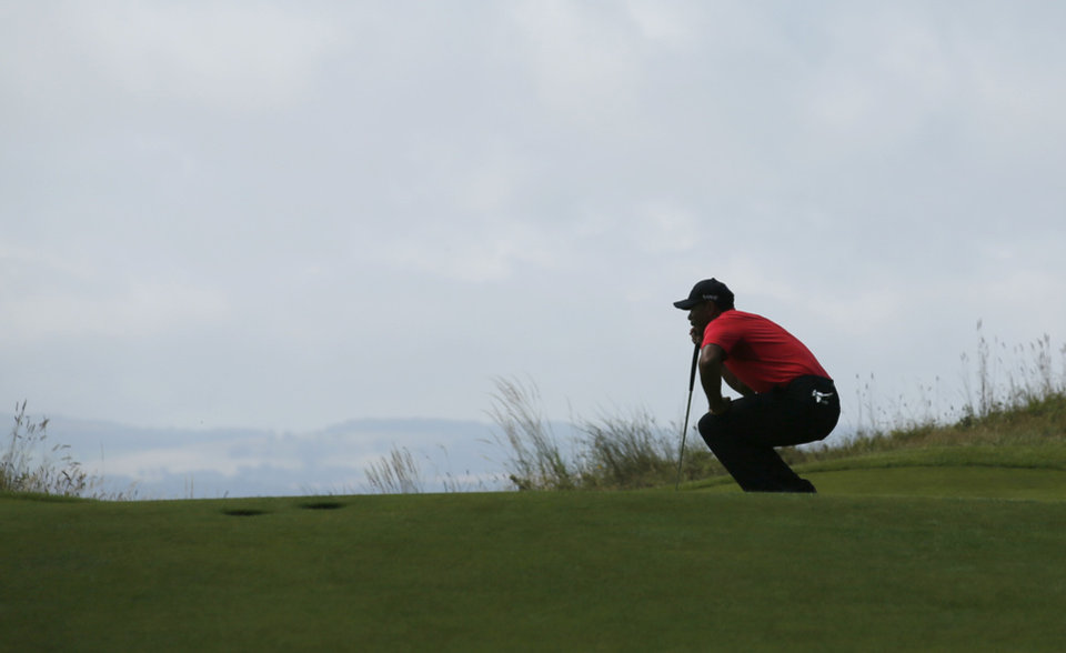 Photo - Tiger Woods of the US lines up a putt on the 13th green during the final round of the British Open Golf championship at the Royal Liverpool golf club, Hoylake, England, Sunday July 20, 2014. (AP Photo/Jon Super)