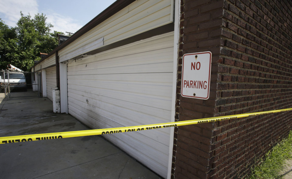 A garage is shown Sunday, July 21, 2013, where a body was found recently in East Cleveland, Ohio.  The bodies, believed to be female, were found about 100 to 200 yards (90 to 180 meters) apart, and a 35-year-old man was arrested and is a suspect in all three deaths, though he has not yet been charged, East Cleveland Mayor Gary Norton said Saturday. (AP Photo/Tony Dejak)