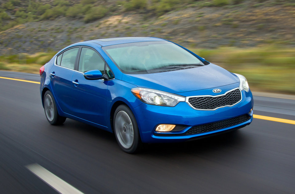 Photo - This undated image made available by Kia shows the 2014 Kia Forte. (AP Photo/Kia, Bruce Benedict)