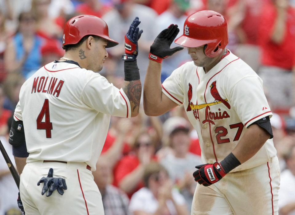 Photo - St. Louis Cardinals' Jhonny Peralta (27) celebrates with teammate Yadier Molina after hitting a solo home run in the fourth inning of a baseball game against the Miami Marlins, Saturday, July 5, 2014, in St. Louis.(AP Photo/Tom Gannam)