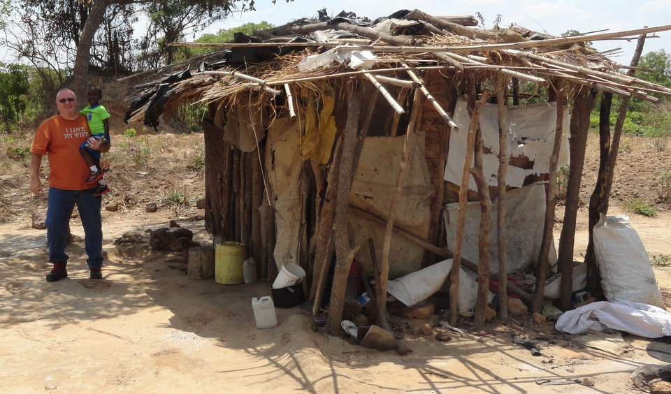 Photo - Randy Cloud and Kangwa visit the hut in Zambia where the child lived after his mother died. Photo provided