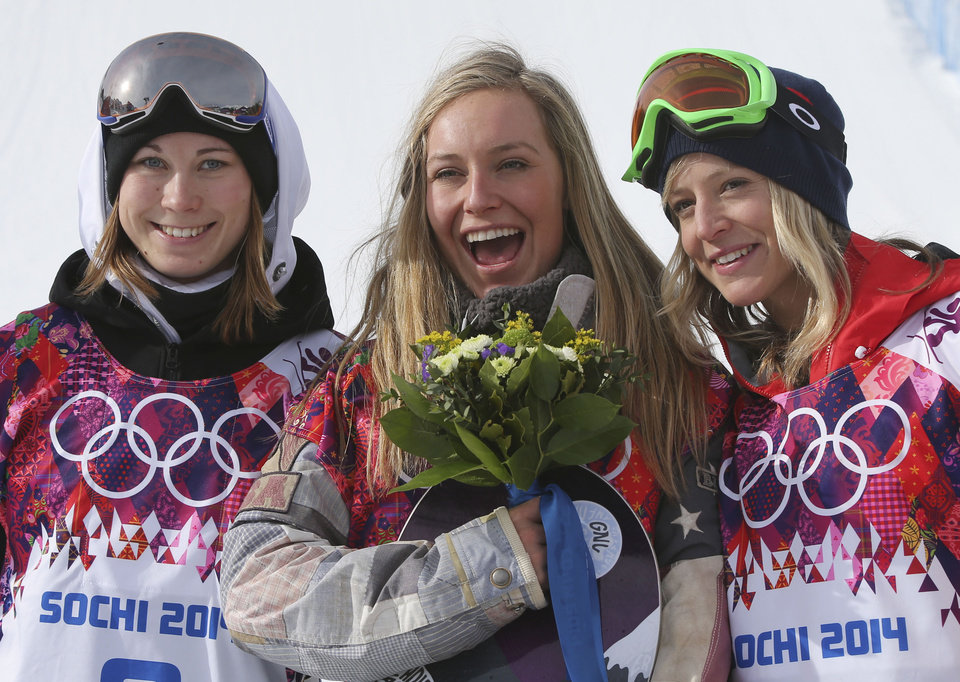 Photo - Jamie Anderson of the United States, center, celebrates with silver medalist Enni Rukajarvi of Finland, left,  and bronze medalist  Jenny Jones of Britain, after Anderson won the women's snowboard slopestyle final at the 2014 Winter Olympics, Sunday, Feb. 9, 2014, in Krasnaya Polyana, Russia. (AP Photo/Sergei Grits)