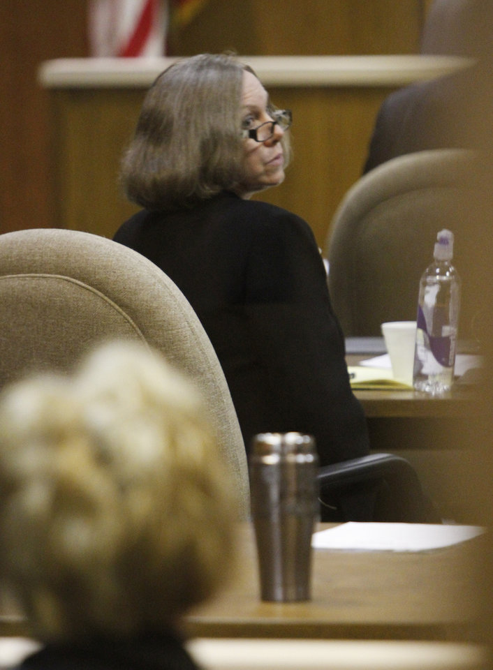 Photo - Rebecca Bryan listens to opening statements during her murder trial in the Canadian County Courthouse in El Reno , Wednesday May 8, 2013. Bryan is accused of killing her husband, Keith Bryan, 52, who was the Nichols Hills fire Chief. Photo By Steve Gooch, The Oklahoman