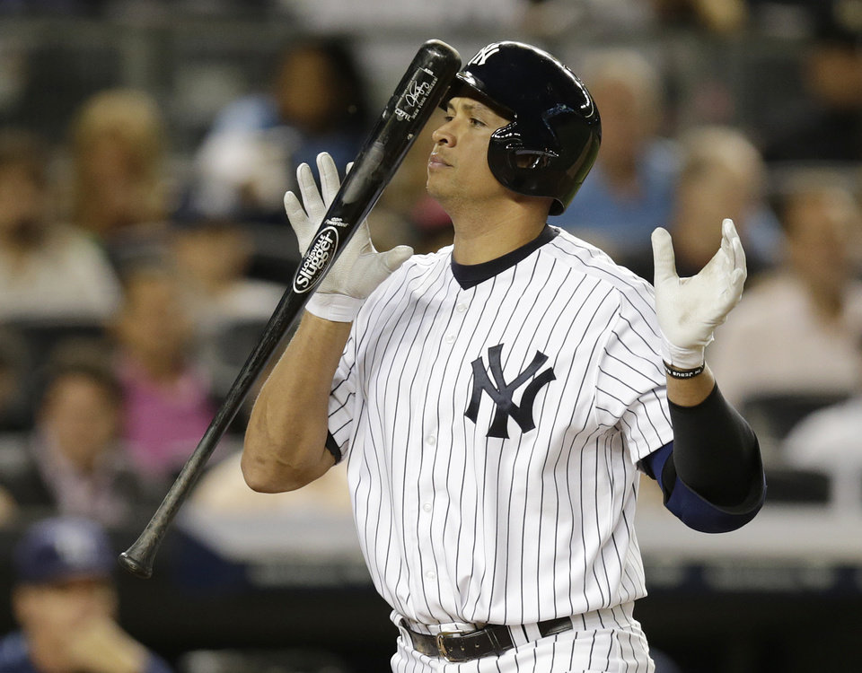 Photo - New York Yankees' Alex Rodriguez heads to the dugout after striking out looking in the fifth inning of a baseball game against the Tampa Bay Rays, Wednesday, Sept. 25, 2013, in New York. (AP Photo/Kathy Willens)