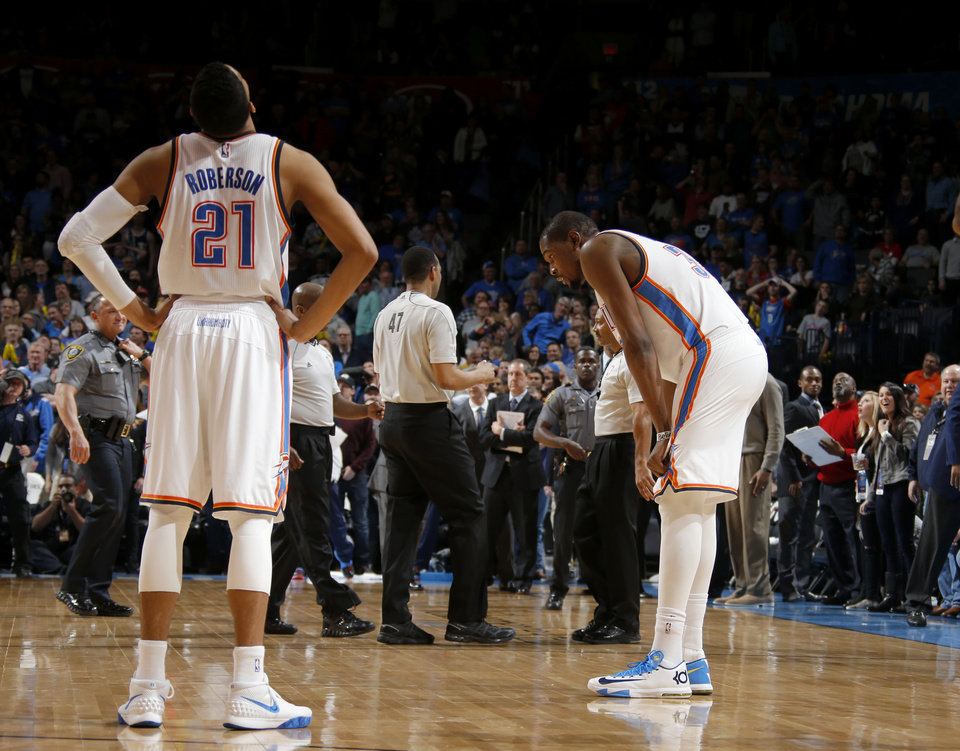 Photo - Oklahoma City's Kevin Durant (35) reacts as Andre Roberson (21) looks up at the replay after a last-second shot gave the Pelicans the win in an NBA game between the Oklahoma City Thunder and the New Orleans Pelicans at Chesapeake Energy Arena on Friday, Feb. 6, 2015. Photo by Bryan Terry, The Oklahoman