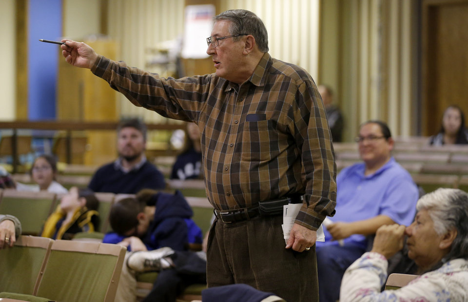 Photo -  Capitol Hill High School graduate Roy Meler argues against plans to drop the school mascot during an educational forum organized by the Native American Parent Committee.   BRYAN TERRY -  THE OKLAHOMAN