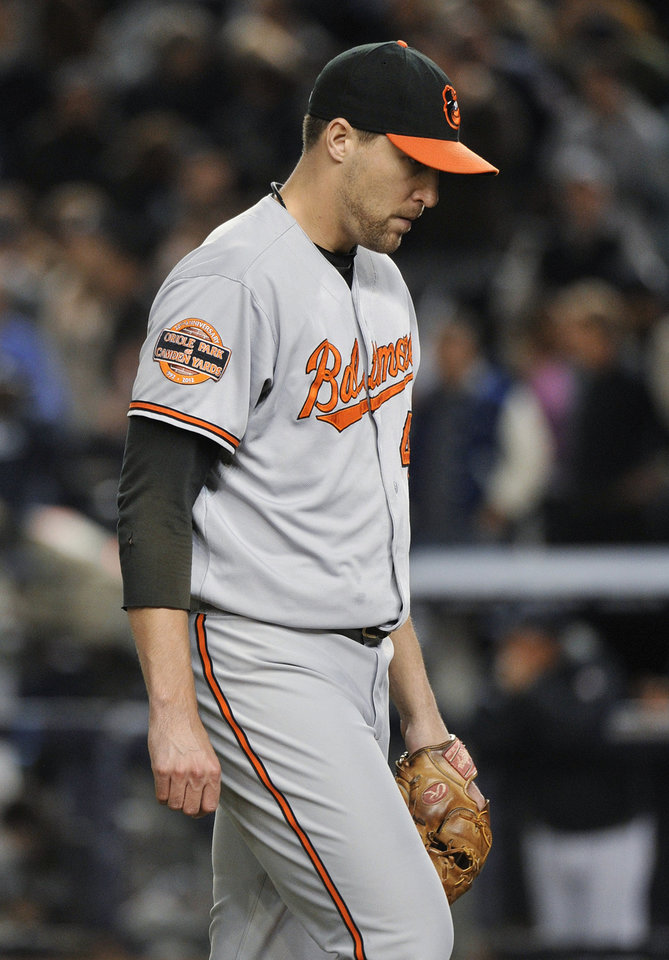 Photo -   Baltimore Orioles relief pitcher Jim Johnson leaves the field after the ninth inning of Game 3 of the Orioles' American League division baseball series against the New York Yankees on Wednesday, Oct. 10, 2012, in New York. (AP Photo/Bill Kostroun)