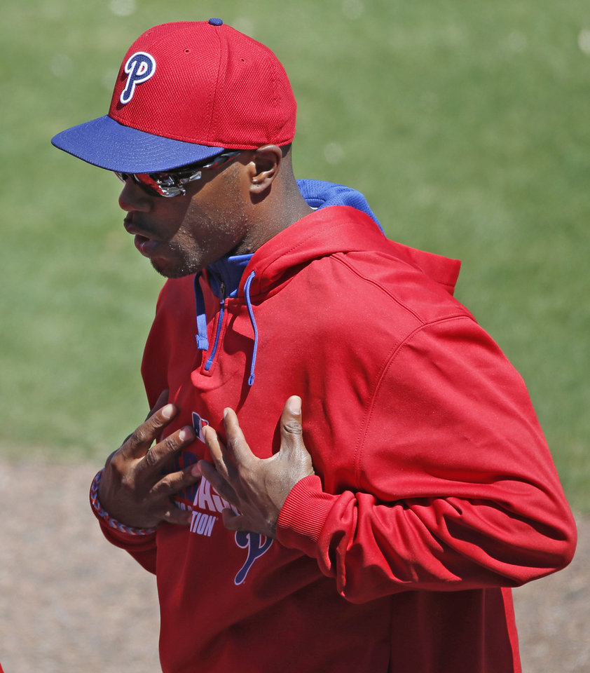 Photo - Philadelphia Phillies shortstop Jimmy Rollins (11) gestures as he leaves the dugout during a spring exhibition baseball game against the New York Yankees in Clearwater, Fla., Thursday, March 13, 2014.  Rollins spoke Thursday and said he is healthy therefore he is not sure why Phillies manager Ryne Sandberg benched him for the third consecutive game. (AP Photo/Kathy Willens)