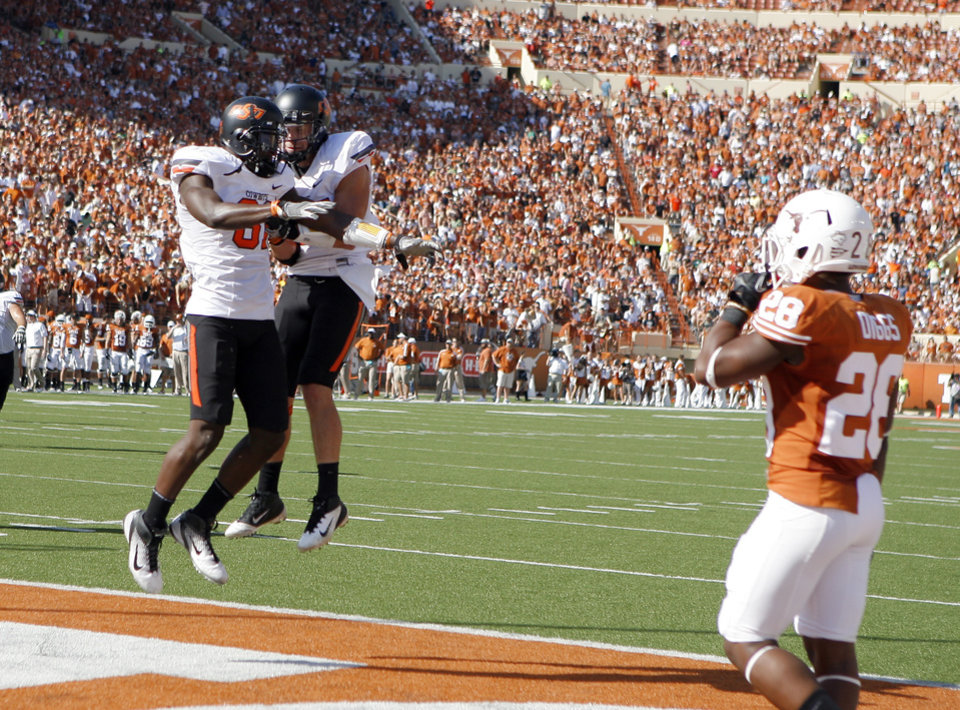 Oklahoma State\'s Justin Blackmon (81) and Josh Cooper (25) celebrate a touchdown in front of Texas\' Quandre Diggs (28) during first half of a college football game between the Oklahoma State University Cowboys (OSU) and the University of Texas Longhorns (UT) at Darrell K Royal-Texas Memorial Stadium in Austin, Texas, Saturday, Oct. 15, 2011. Photo by Sarah Phipps, The Oklahoman
