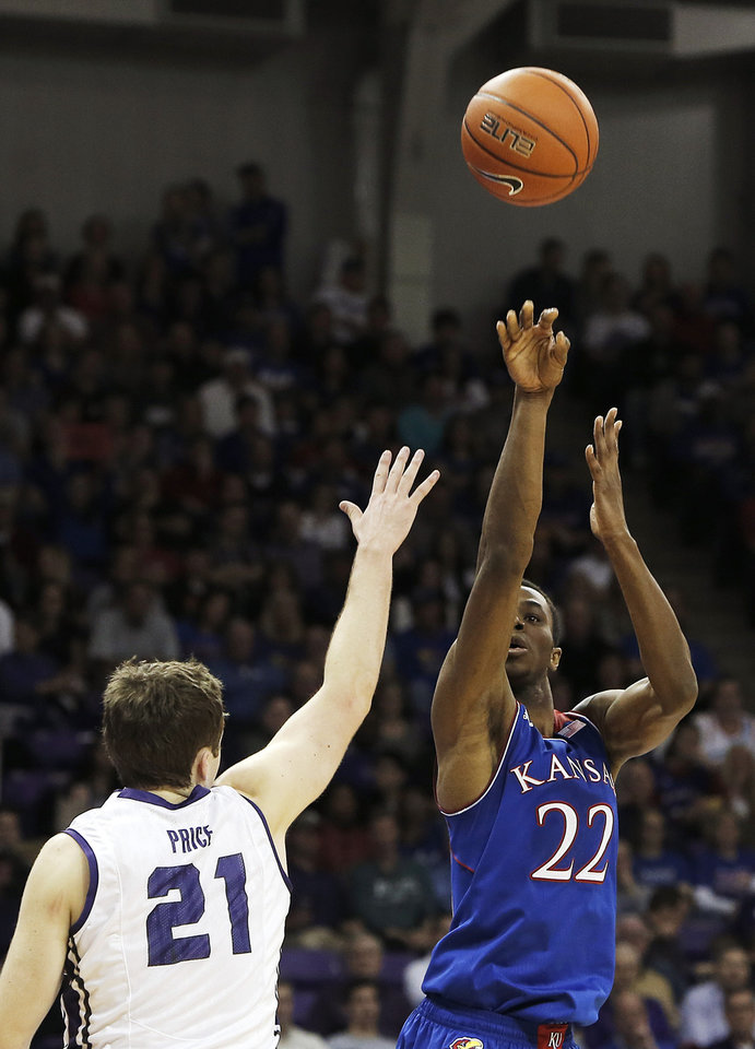 Photo - Kansas guard Andrew Wiggins (22) attempts a shot as TCU's Hudson Price (21) defends in the first half of an NCAA college basketball game, Saturday, Jan. 25, 2014, in Fort Worth, Texas. (AP Photo/Brandon Wade)