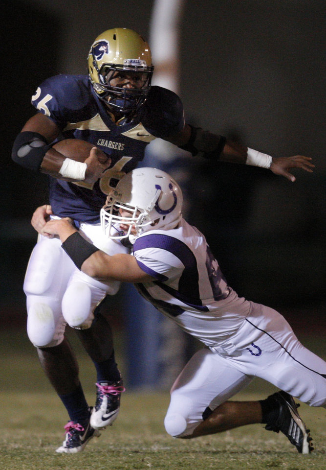 Bethany's Jacob Nelson brings down Heritage Hall's Barry Sanders during the high school football game between Heritage Hall and Bethany at Heritage Hall in Oklahoma City, Friday, Oct. 28, 2011. Photo by Sarah Phipps, The Oklahoman