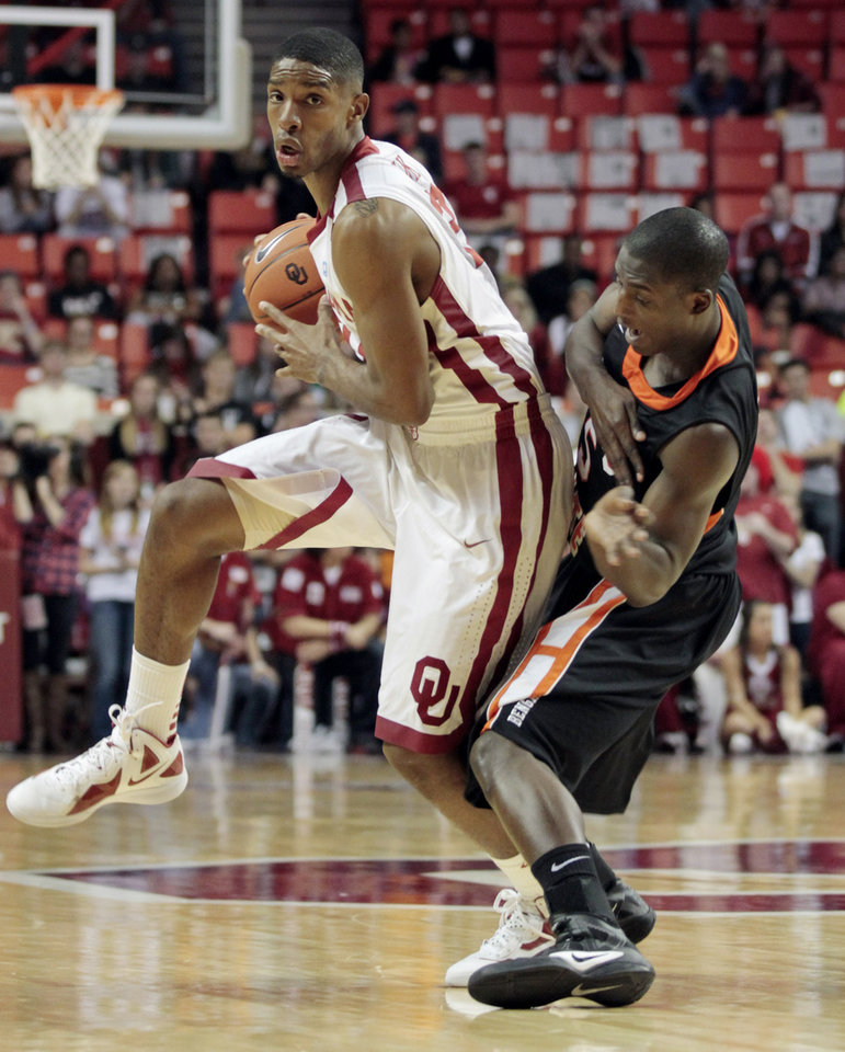 Oklahoma's Cameron Clark (21) tries to get past Idaho State's Sherrod Baldwin (5) as the University of Oklahoma Sooner men's basketball team defeats the Idaho State Bengals 78-74 at the Lloyd Noble Center on Friday, Nov. 11, 2011, in Norman, Okla.  Photo by Steve Sisney, The Oklahoman