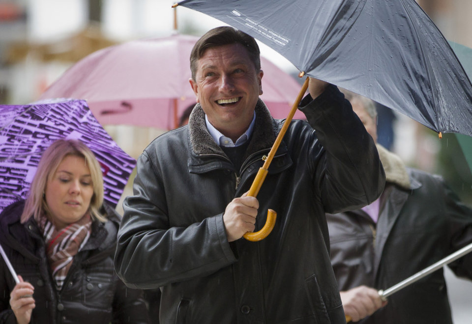 Photo - Slovenia's former prime minister Borut Pahor arrives at a polling station in Sempeter, Slovenia, Sunday, Dec. 2, 2012. Small, crisis-hit EU member Slovenia is choosing a president in an atmosphere of uncertainty and growing discontent with cost-cutting measures designed to avoid an international bailout. (AP Photo/Darko Bandic)