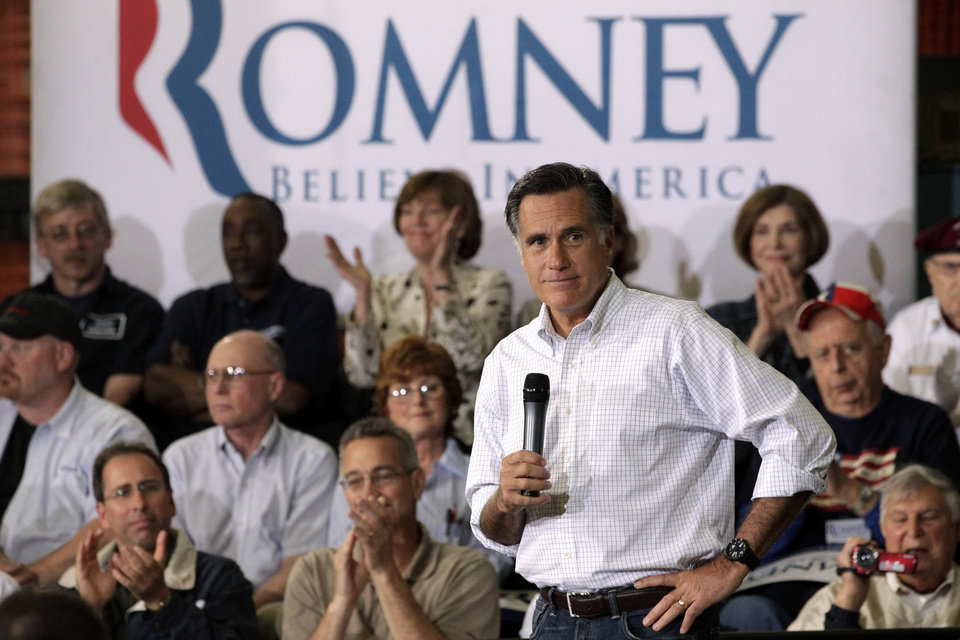 Photo -   Republican presidential candidate, former Massachusetts Gov. Mitt Romney speaks at a town hall-style meeting in Euclid, Ohio, Monday, May 7, 2012. (AP Photo/Jae C. Hong)