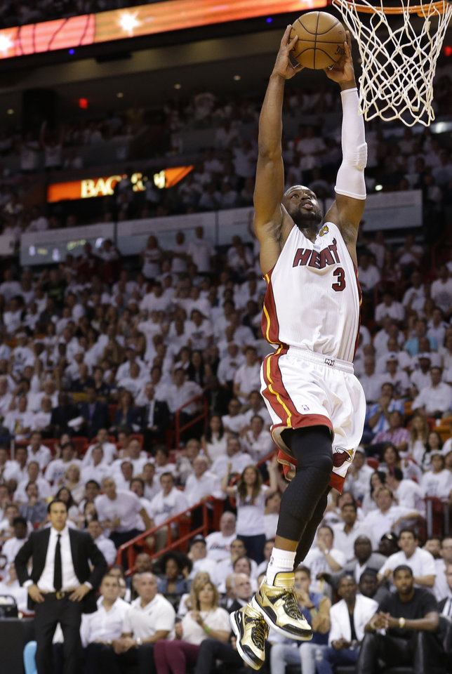 Miami Heat's Dwyane Wade (3) dunks the ball against the San Antonio Spurs during the second half in Game 7 of the NBA basketball championships, Thursday, June 20, 2013, in Miami. (AP Photo/Lynne Sladky)