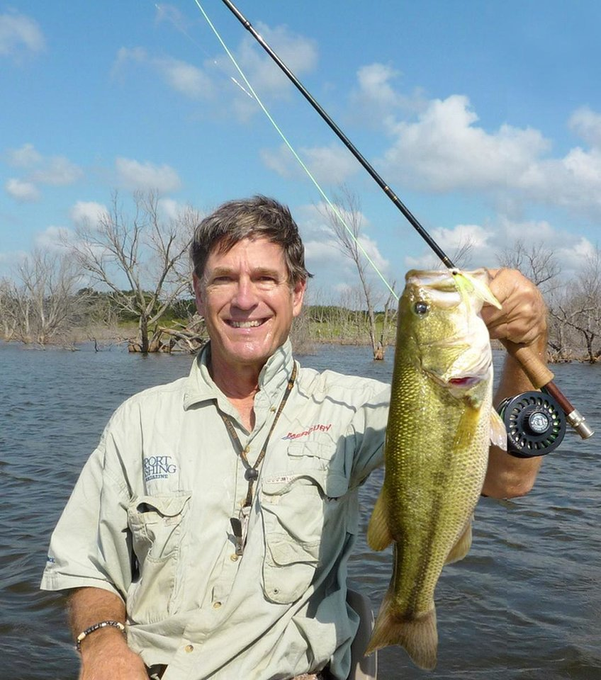 Photo - FISHING / FISH: The author, Hal McKnight of Oklahoma City, holds a 7-pound bass caught on a fly rod. 		ORG XMIT: 0911210012395914