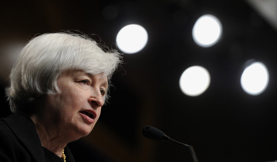 Photo - Federal Reserve Chair Janet Yellen speaks at the International Monetary Fund in Washington, Wednesday, July 2, 2014.  Yellen said she doesn't see a need for the Fed to start raising interest rates to address the risk that extremely low rates could destabilize the financial system.  (AP Photo/Susan Walsh)