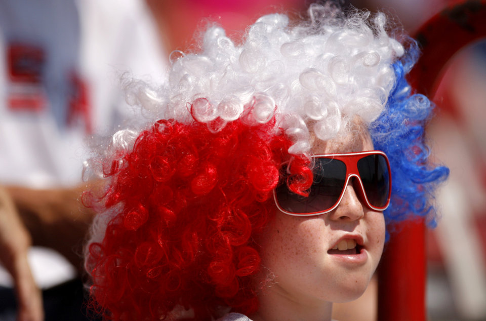 Ryan Biehl, 10, of Folsom, Calif., watches during the World Cup of Softball game between USA and the Netherlands at ASA Hall of Fame Stadium in Oklahoma City, Saturday, June 30, 2012. USA won 2-1. Photo by Bryan Terry, The Oklahoman
