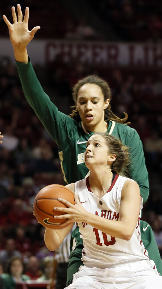 Photo - Oklahoma's Morgan Hook (10) moves to the basket in front of Baylor's Brittney Griner (42) during a women's college basketball game between the University of Oklahoma (OU) and Baylor at the Lloyd Noble Center in Norman, Okla., Monday, Feb. 25, 2013. Photo by Nate Billings, The Oklahoman
