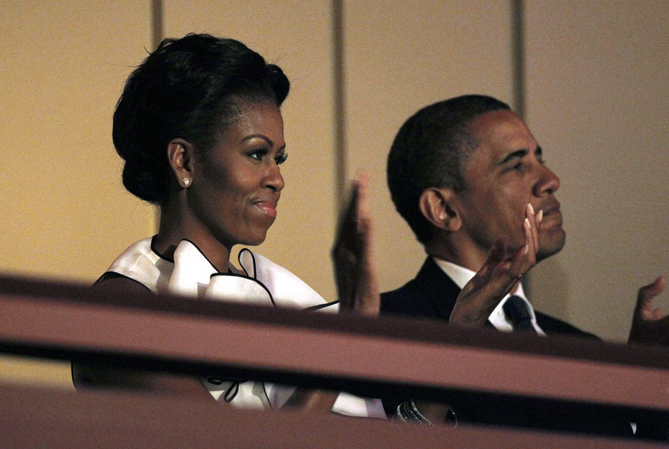 "President Barack Obama and first lady Michelle Obama applaud as they attend ""A Concert for Hope"" at the Kennedy Center in Washington, Sunday, Sept. 11, 2011, on the 10th anniversary of the Sept. 11 terrorist attacks. (AP Photo/Charles Dharapak)"