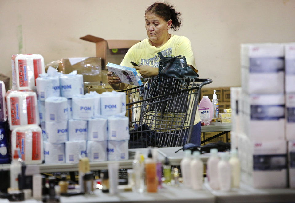 Photo - Mary DeJulius of Moore shops for household items at the