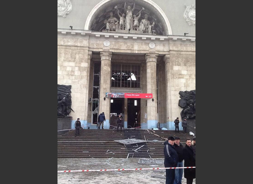 Photo - In this photo taken on a cell phone, made available by Volgograd Mayor's Office, debris lies outside an entrance to Volgograd railway station, Sunday, Dec. 29, 2013. More then a dozen people were killed and scores were wounded Sunday by a suicide bomber at a railway station in southern Russia, officials said, heightening concern about terrorism ahead of February's Olympics in the Black Sea resort of Sochi. (AP Photo/Nikita Baryshev,Volgograd Mayor's Office Handout)